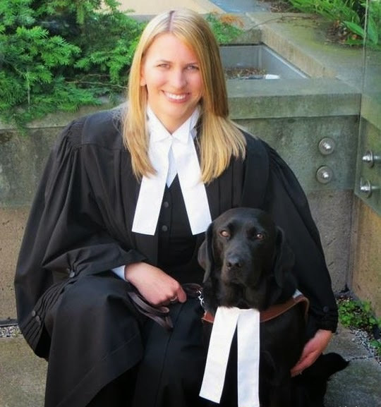 Carrie Moffatt with her guide dog Casey.