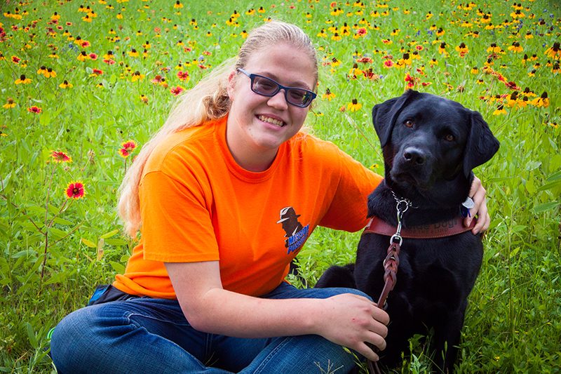 Faith Snapp with her guide dog Prim.