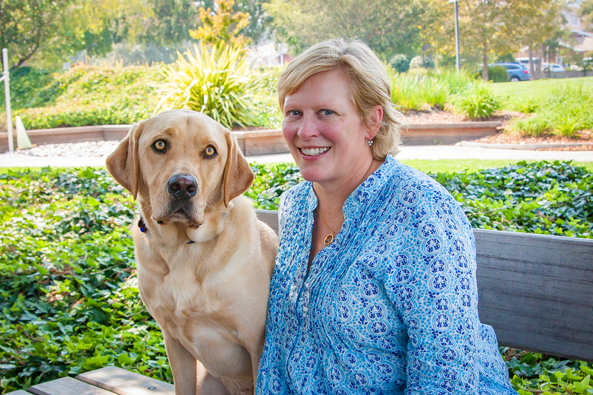 Laura Scarborough Imeson with a yellow Lab career change dog.