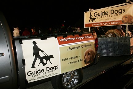"""Sign reads on truck with GDB logo: Volunteer Puppy Raisers - Southern CA. """"Raise a puppy...change a life."""""""