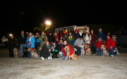 Big group shot made up of puppy raisers with their puppies and GDB graduates with their guide dogs.