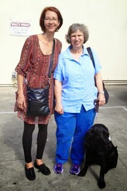 Marlene Dunaway and her guide dog Lava with one of Lava's puppy raisers.