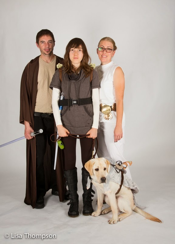 Yellow lab puppy Smitty dressed up with three fellow Star Wars characters.