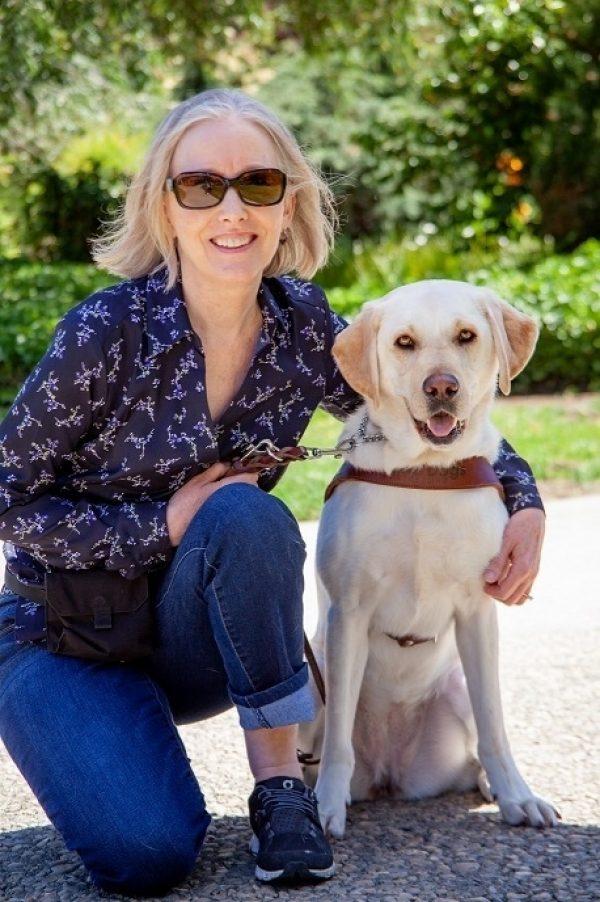 Ann Ulibarri and her guide dog Woon