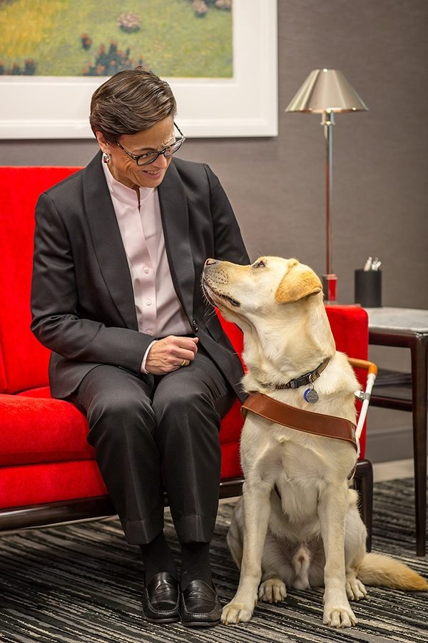 Legacy Society member Deb Swenson with her yellow Lab guide dog, Samurai.