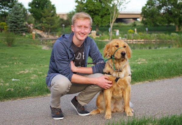 Ian with a Golden Retriever guide dog puppy.