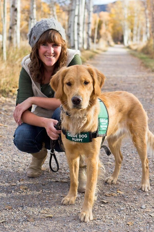 Sarah Jensen with one of the guide dog puppies that she raised.