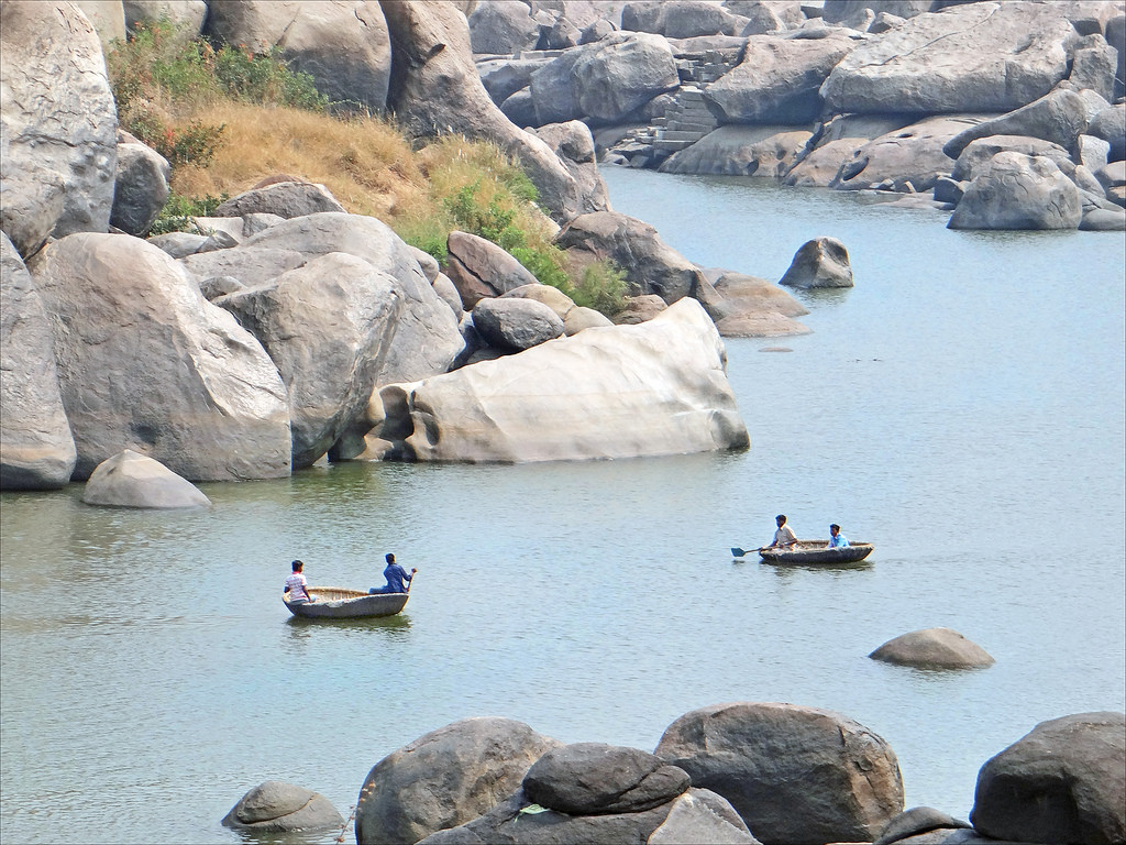 The cute coracles in a rather placid Tungabhadra. Picture Courtesy: Vinoth Chandar