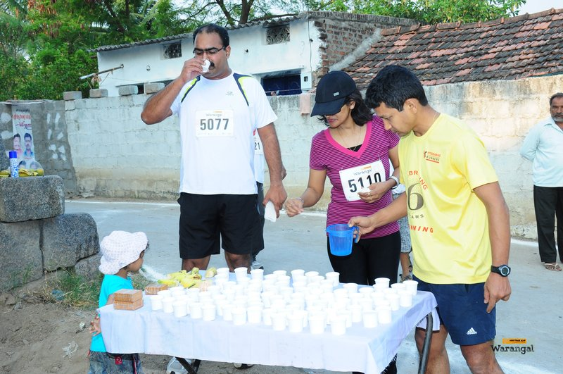 Romil and his daughter manning the 5k aid station