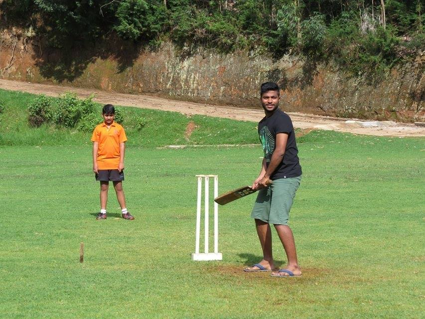 Playing cricket at The Lawrence School grounds
