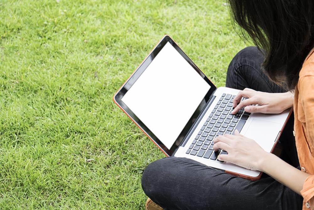 woman using laptop outside to illustrate black google concept