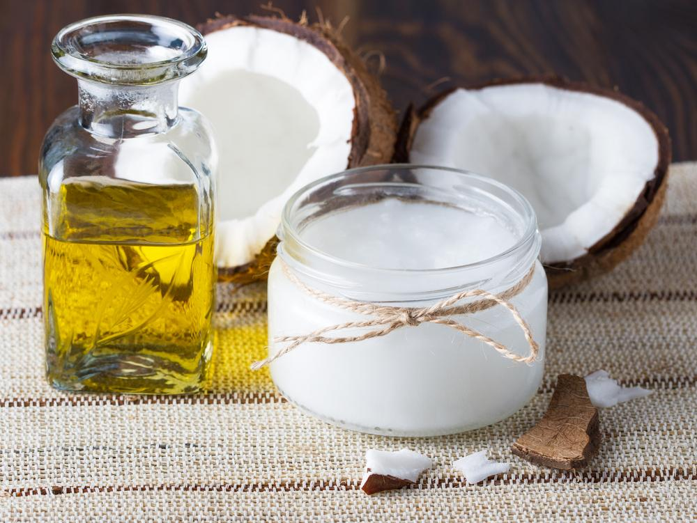 Does coconut oil expire? This concept photo of a coconut and oil illustrates the question.