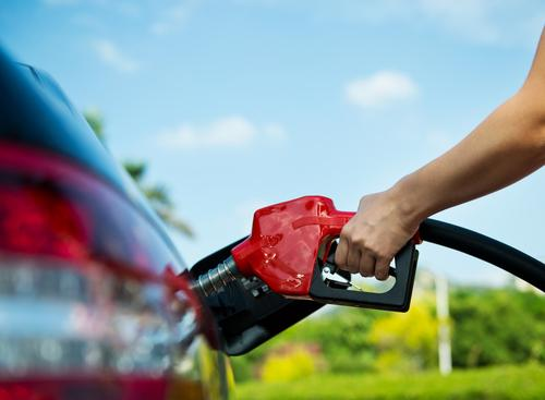 Person fueling up car