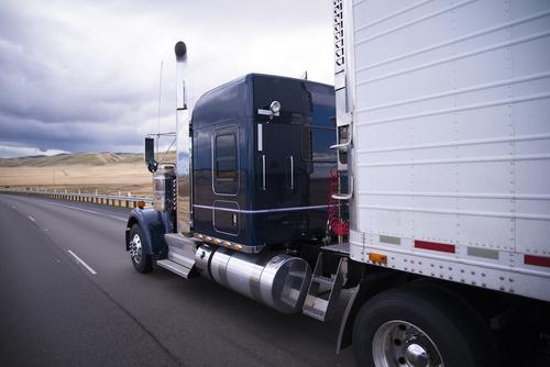 Diesel emissions: semitruck driving down road