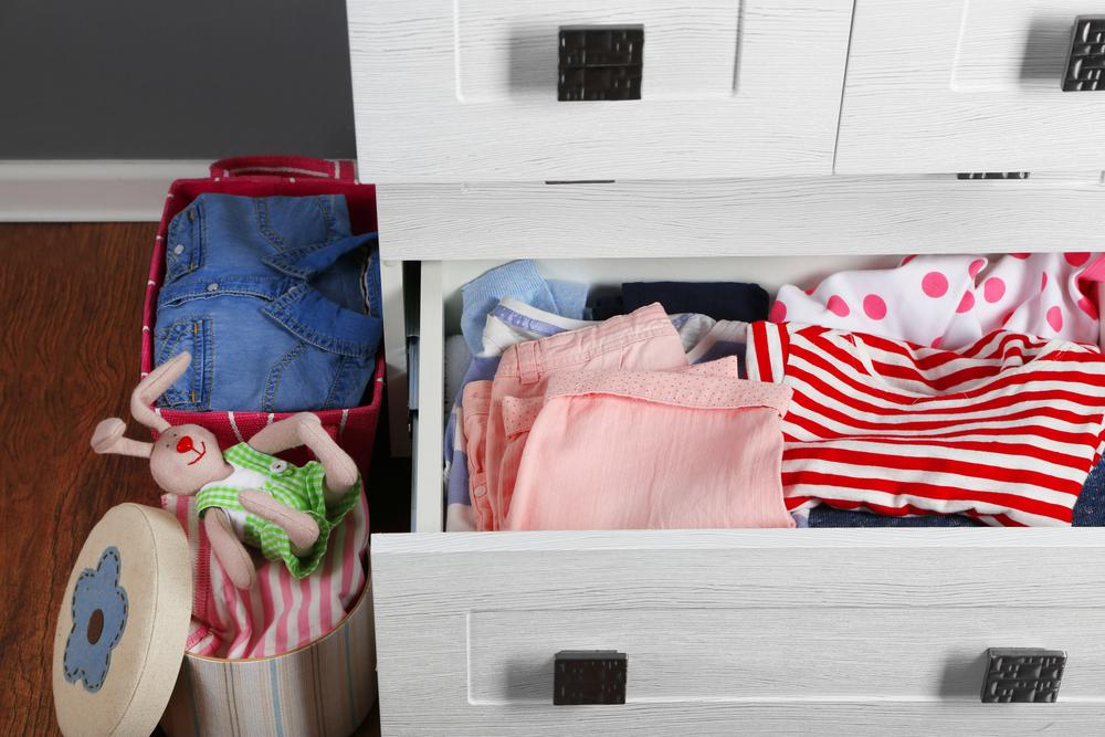 used children's clothes in a drawer