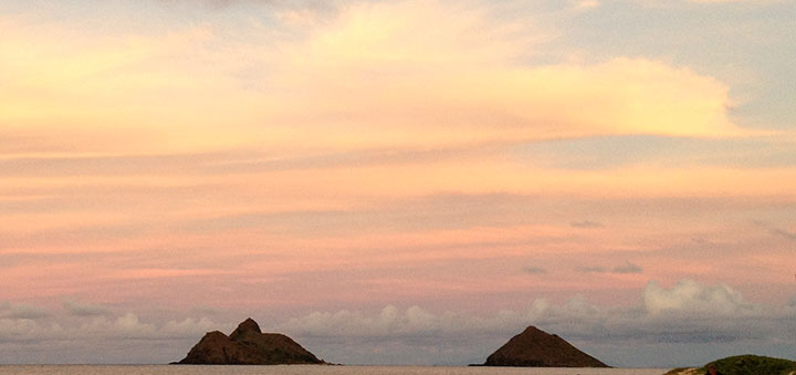 Mokulua islands at sunset off of Lanikai beach.  Photo courtesy of Napua Heen.