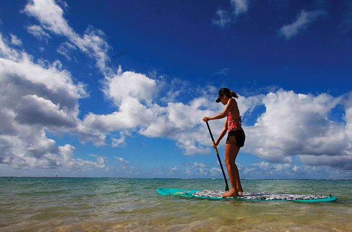 Stand up paddleboard or SUP.  Photo courtesy of Star Advertiser.