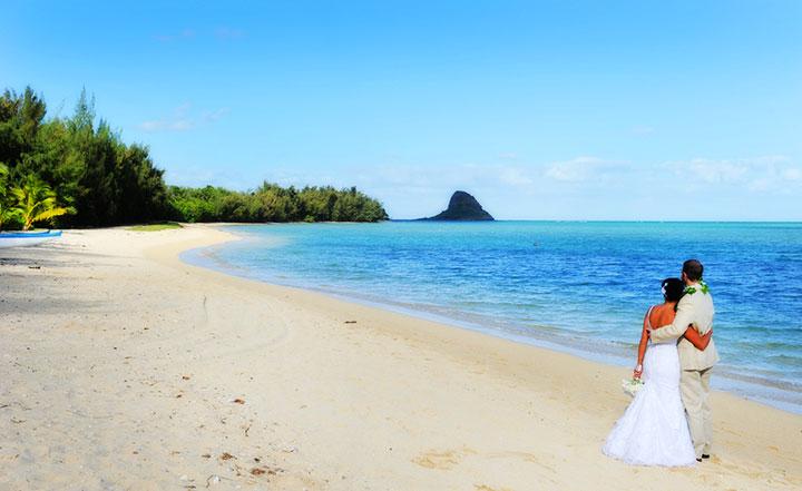 Secret beach wedding photo courtesy of Kualoa Ranch.