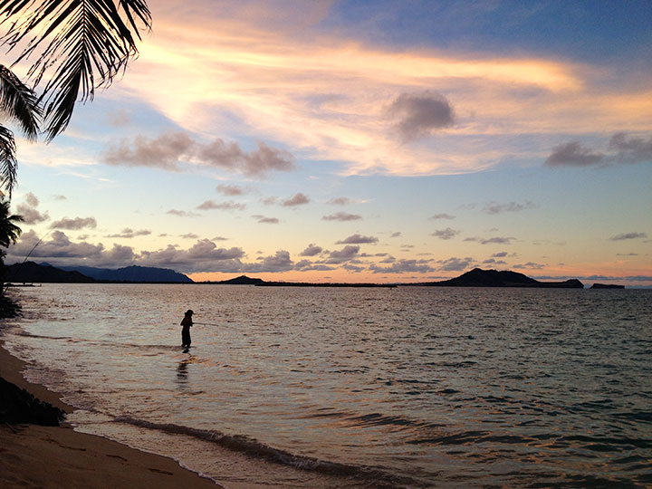 Fisherman at sunset on Lanikai Beach, Kailua, Oahu.  Photo courtesy of Napua Heen.