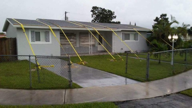 strapping_down_roof_for_hurricane.jpg