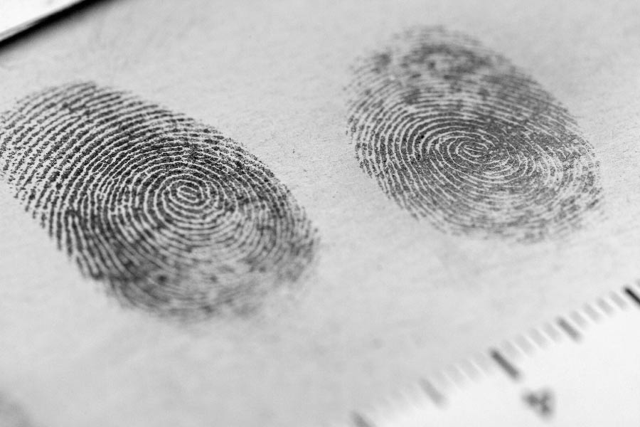 Fingerprints being taken after embezzlement
