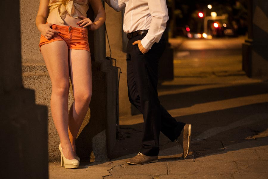 A prostitute has a conversation with a potential John