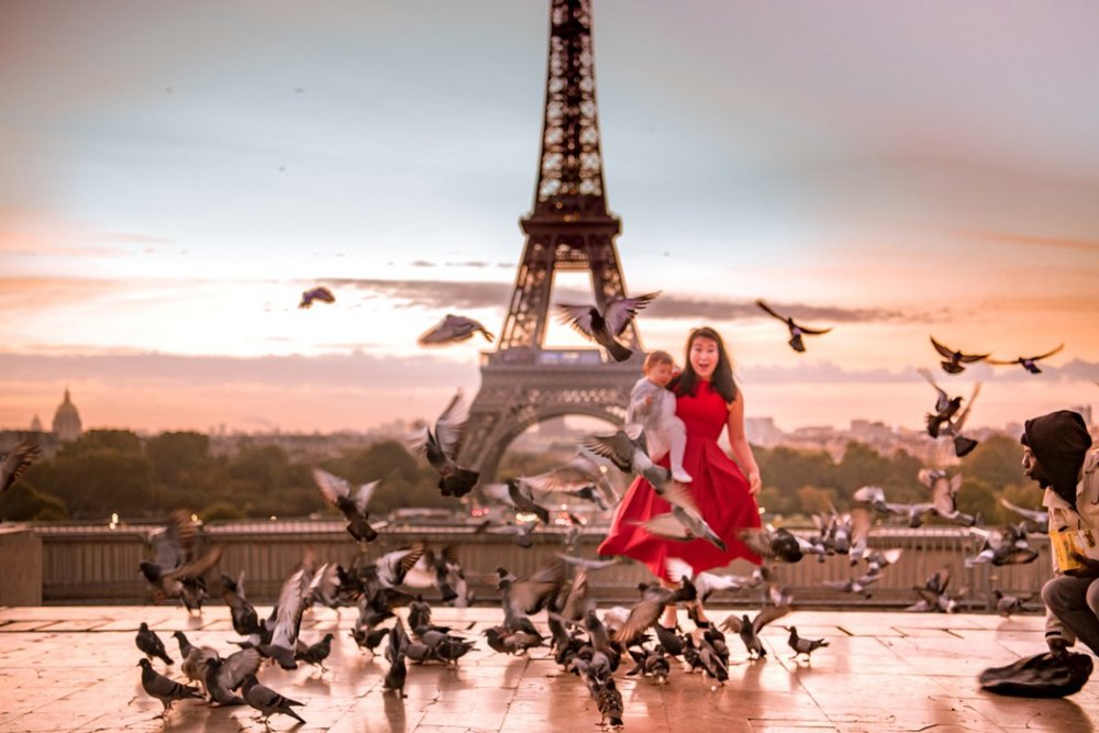 Yet another photo of pigeons flying in front of the Eiffel Tower.