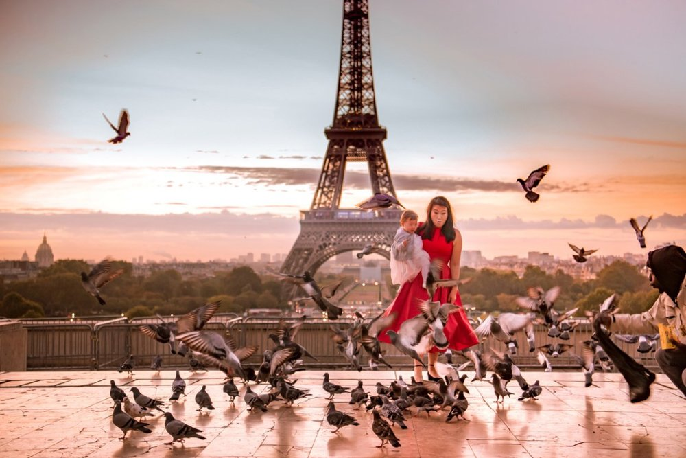 Getting a little help making the pigeons take off during our Eiffel Tower photo shoot.