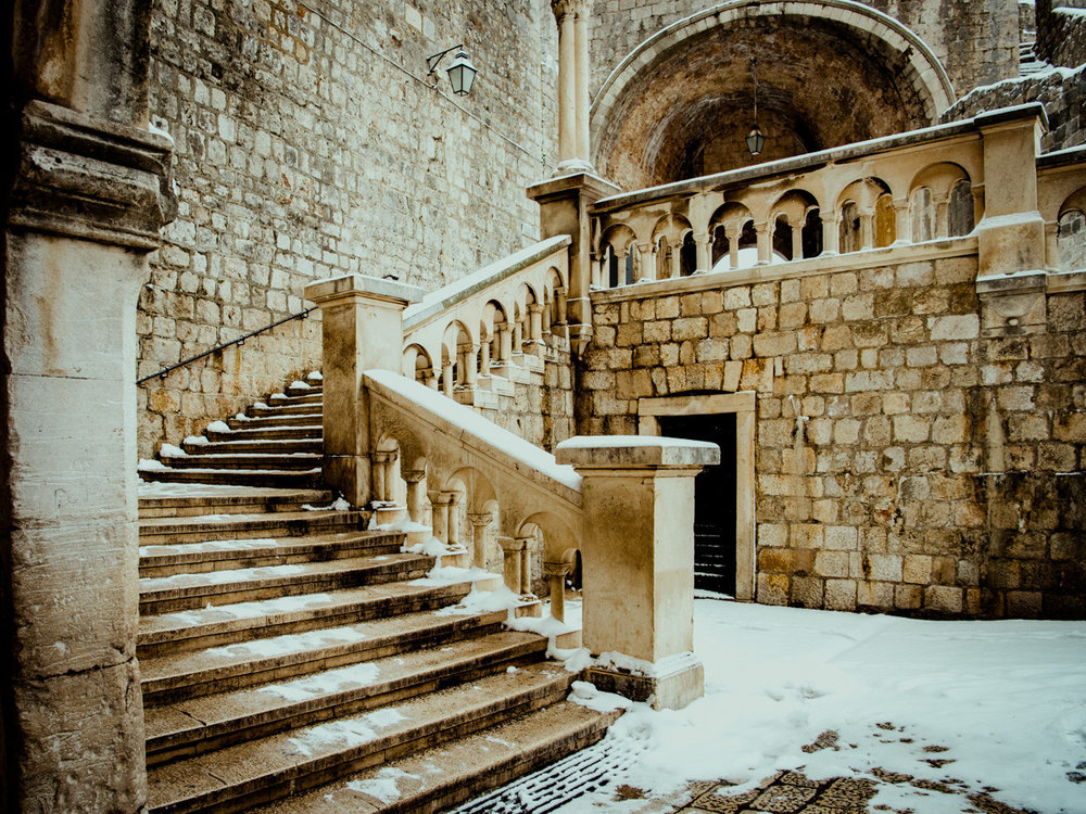 Snow on the stairs near the pile gate in Dubrovnik Croatia in Winter