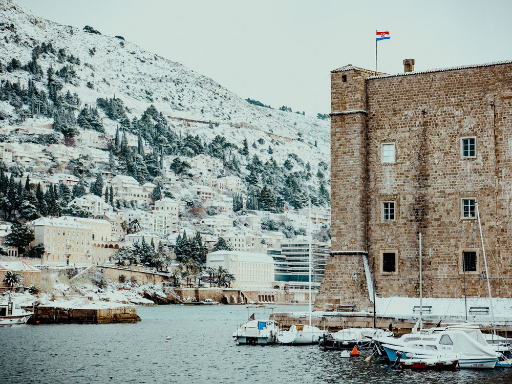 Rare snow covering the harbor in Dubrovnik in Winter.