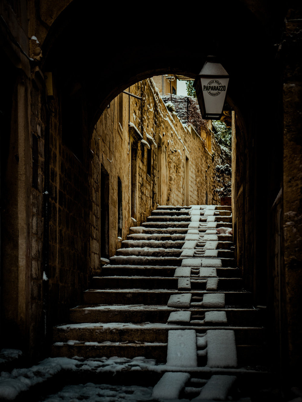 One of Dubrovnik, Croatia's many alleyways, with freshly fallen snow.