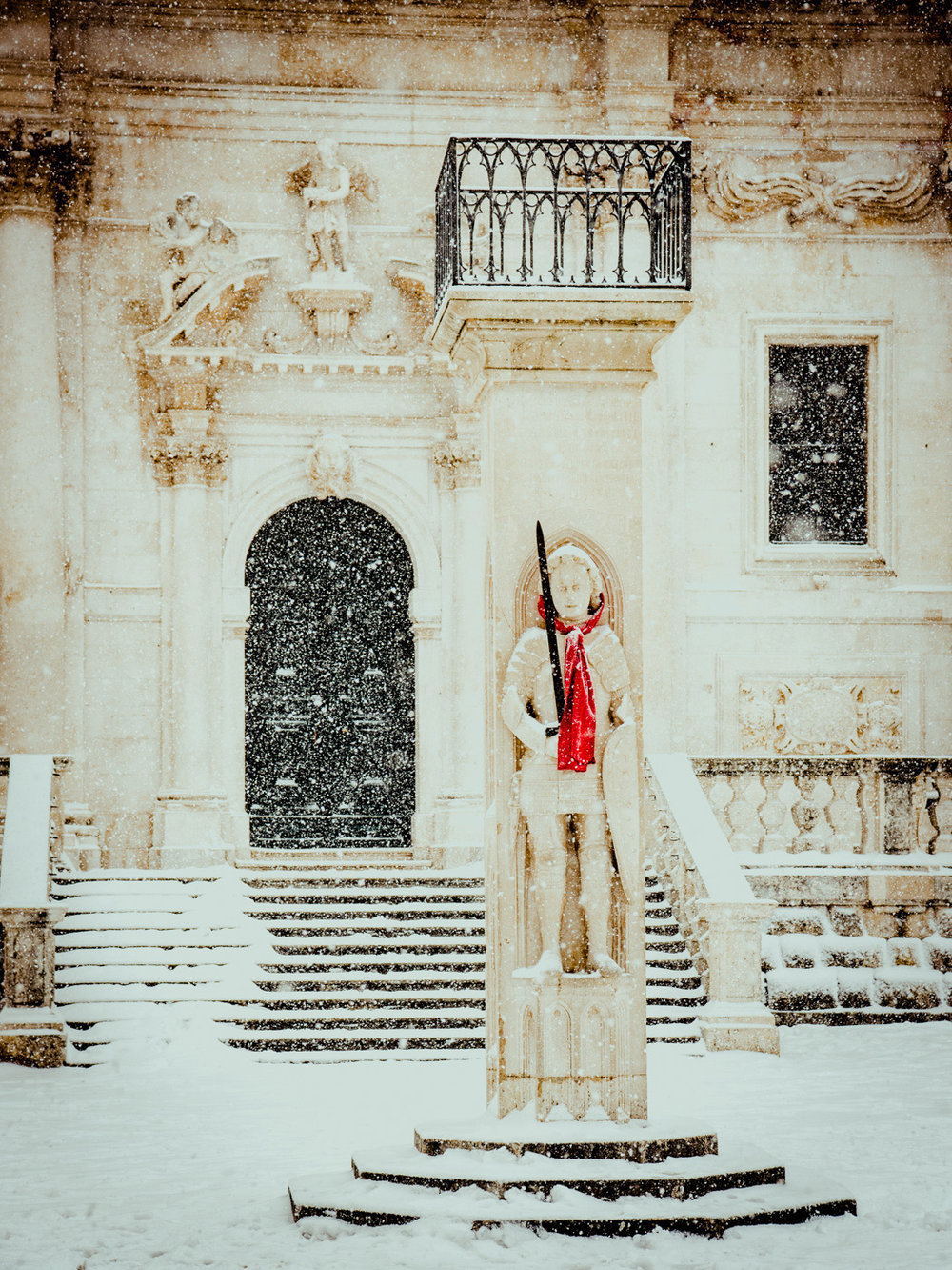 A statue covered in snow in Dubrovnik, Croatia.