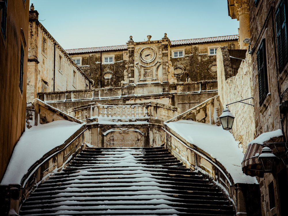 Snow has fallen on the most famous stairs in Dubrovnik, Croatia.