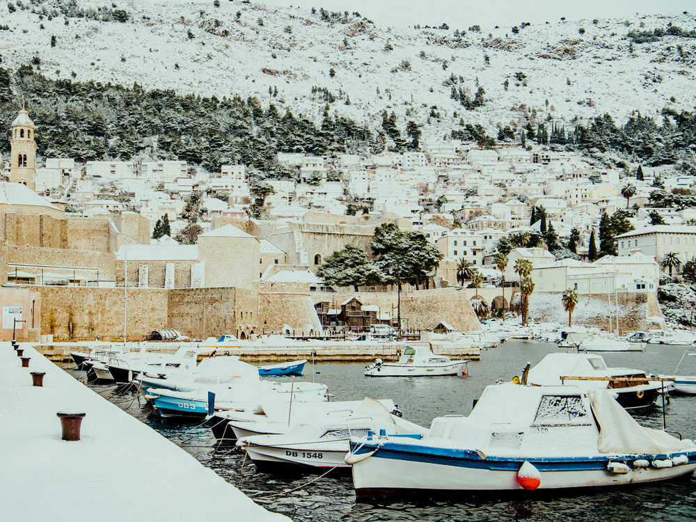 Dubrovnik harbor with freshly fallen snow. Winter in Croatia is beautiful.