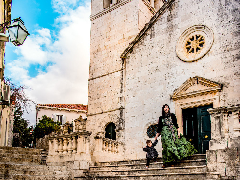 Climbing down church steps in Cavtat, Croatia, near Dubrovnik.