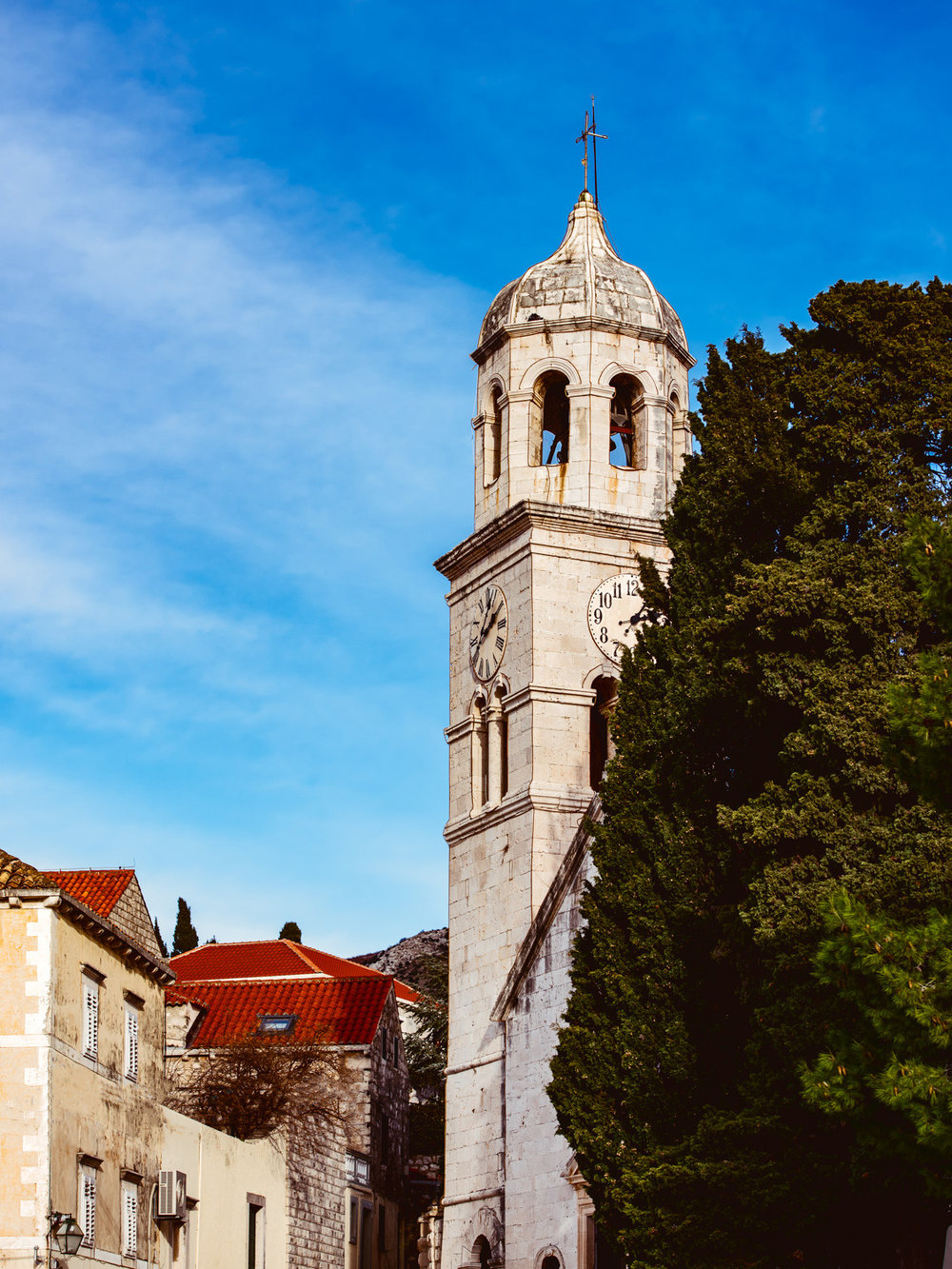A beautiful steeple in the quiet town of Cavtat Croatia on our day trip from Dubrovnik.