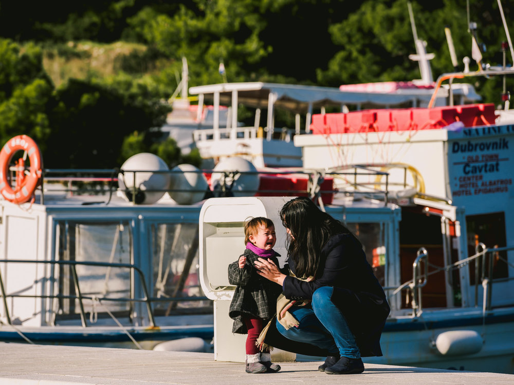 Crying after a fall on the Cavtat, Croatia docks.