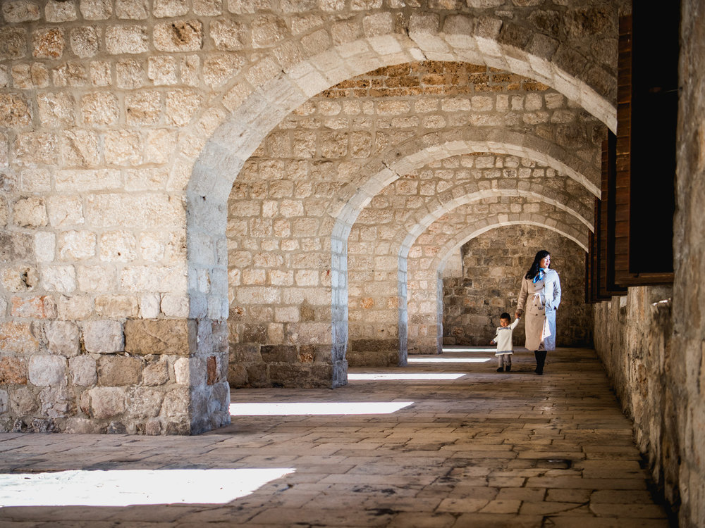walking under arches in the interior of fort lovrijenac.