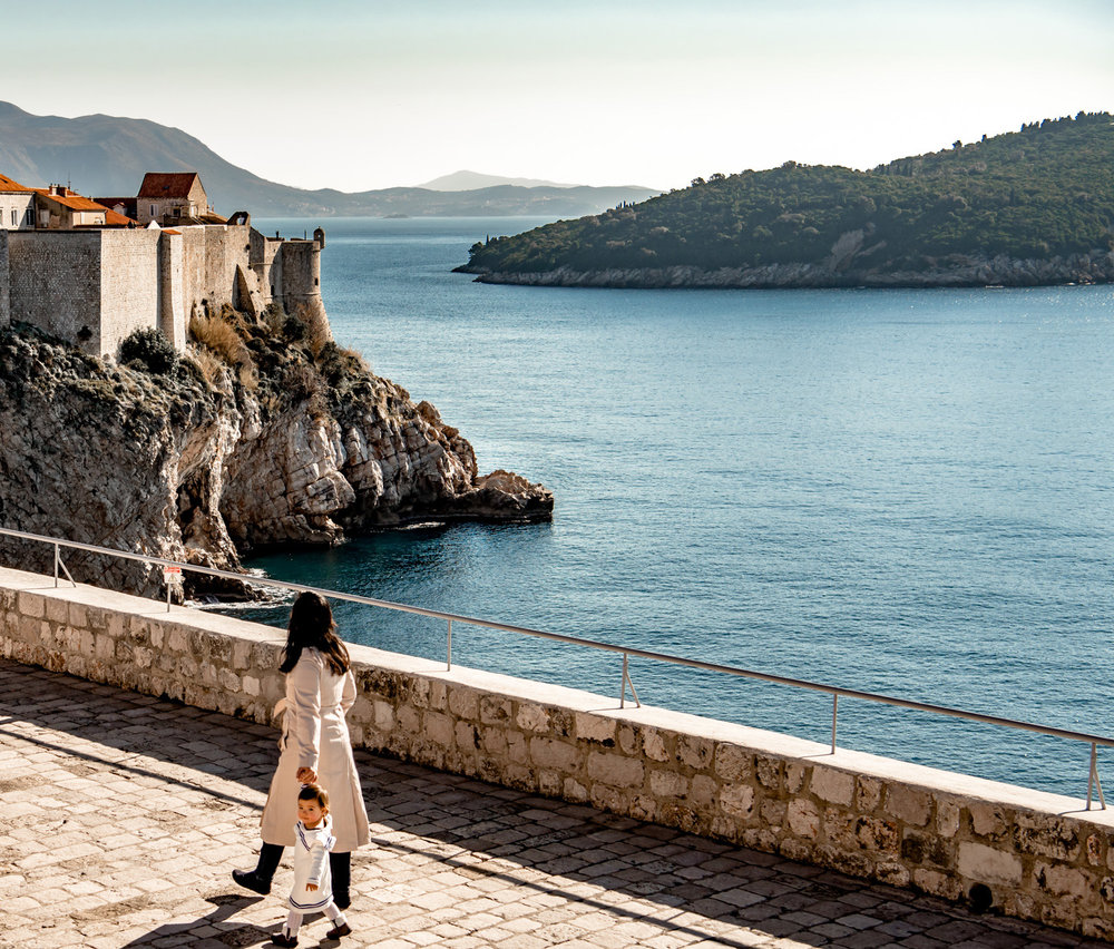 walking on top of fort lovrijenac in Dubrovnik Croatia. the city walls are in the background.