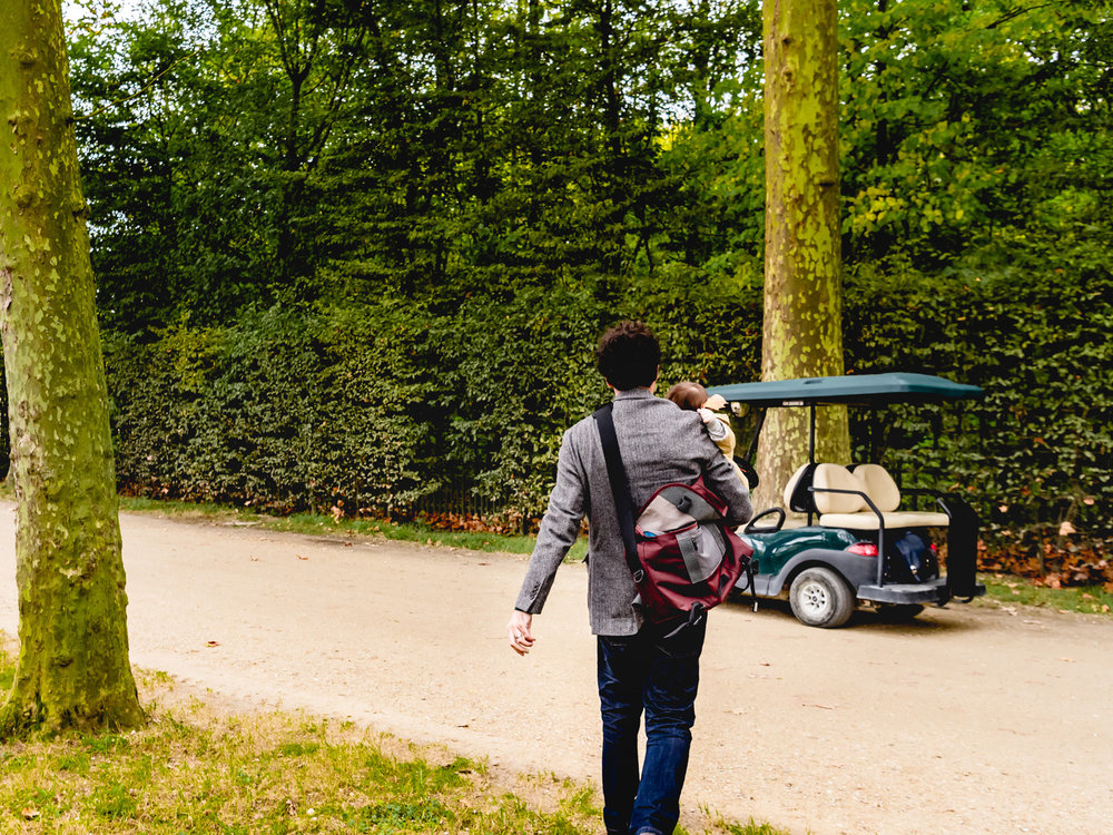 Getting around the versailles gardens in a golf cart.