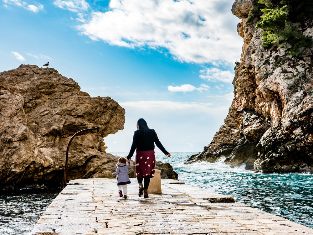 Walking on the stone pier just outside the Pile Gate of Dubrovnik, Croatia.