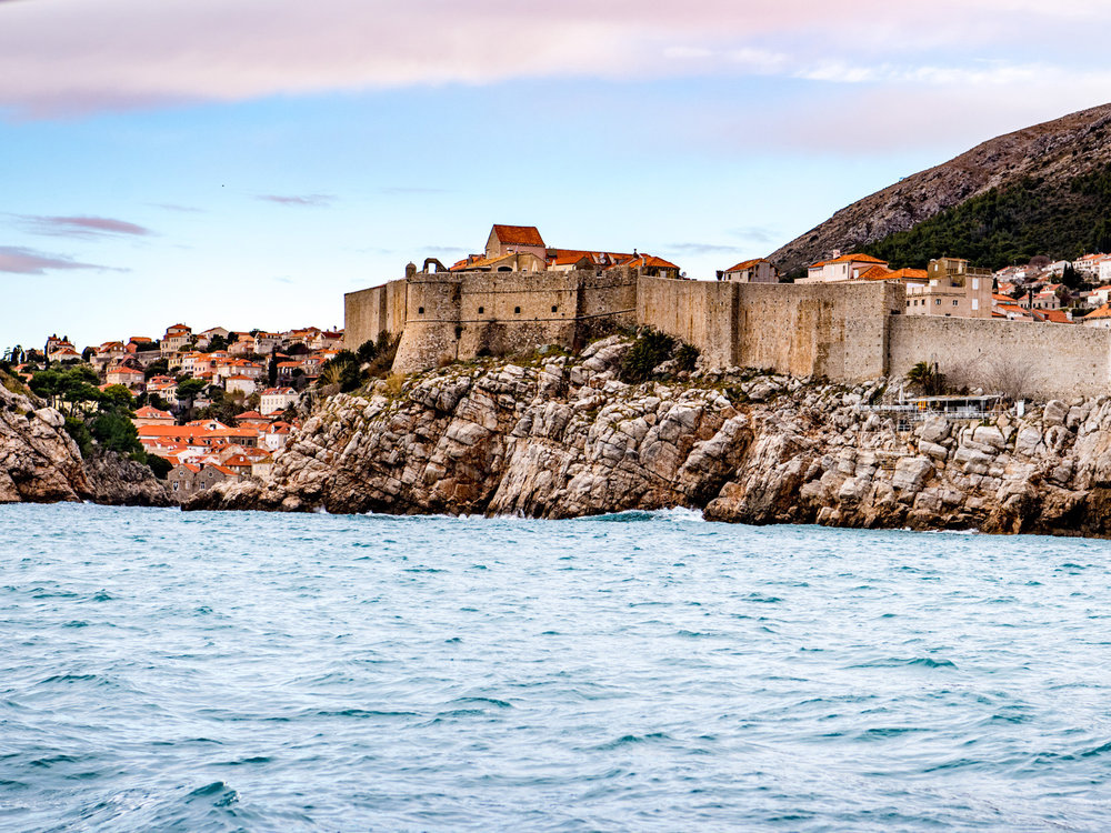 The city walls of Dubrovnik, Croatia, rising over the Adriatic Sea.