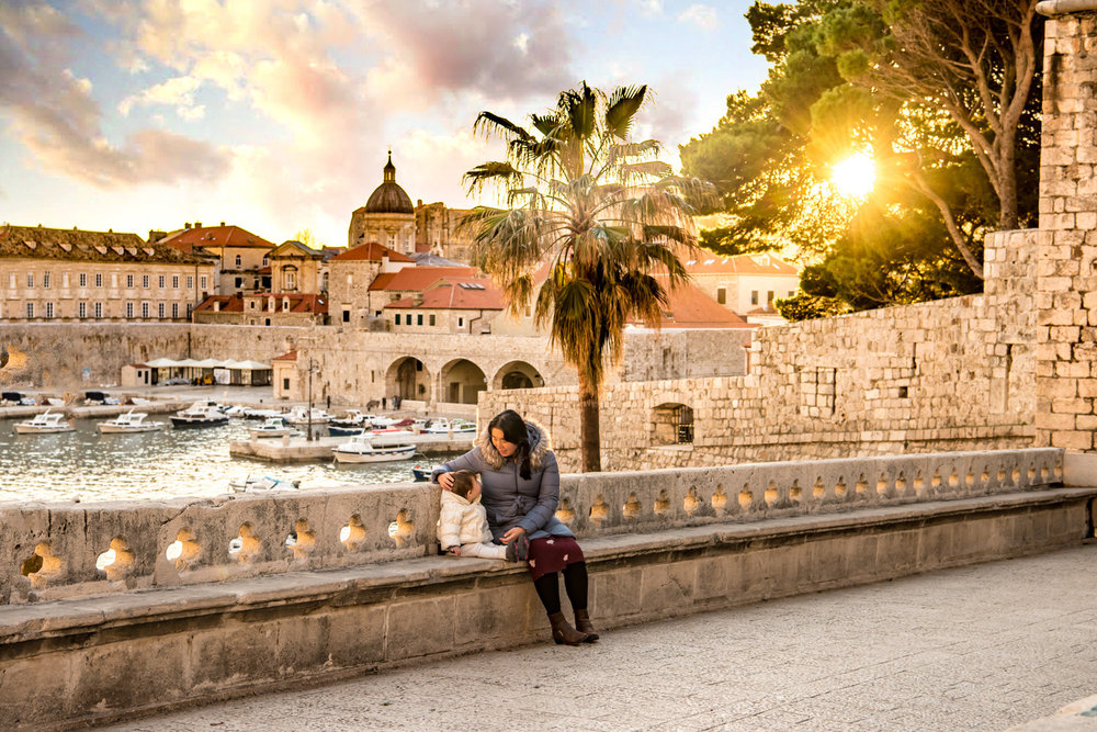 The old town harbor of Dubrovnik Croatia, viewed from the ploce gate at sunset.