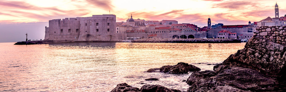 Dubrovnik Croatia's Old Town Harbor at sunset.