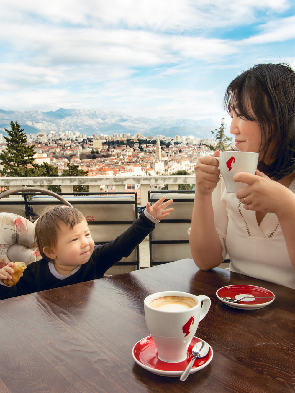 """Sharing"" some hot chocolate at Vidilica Cafe, with Split, Croatia in the background."