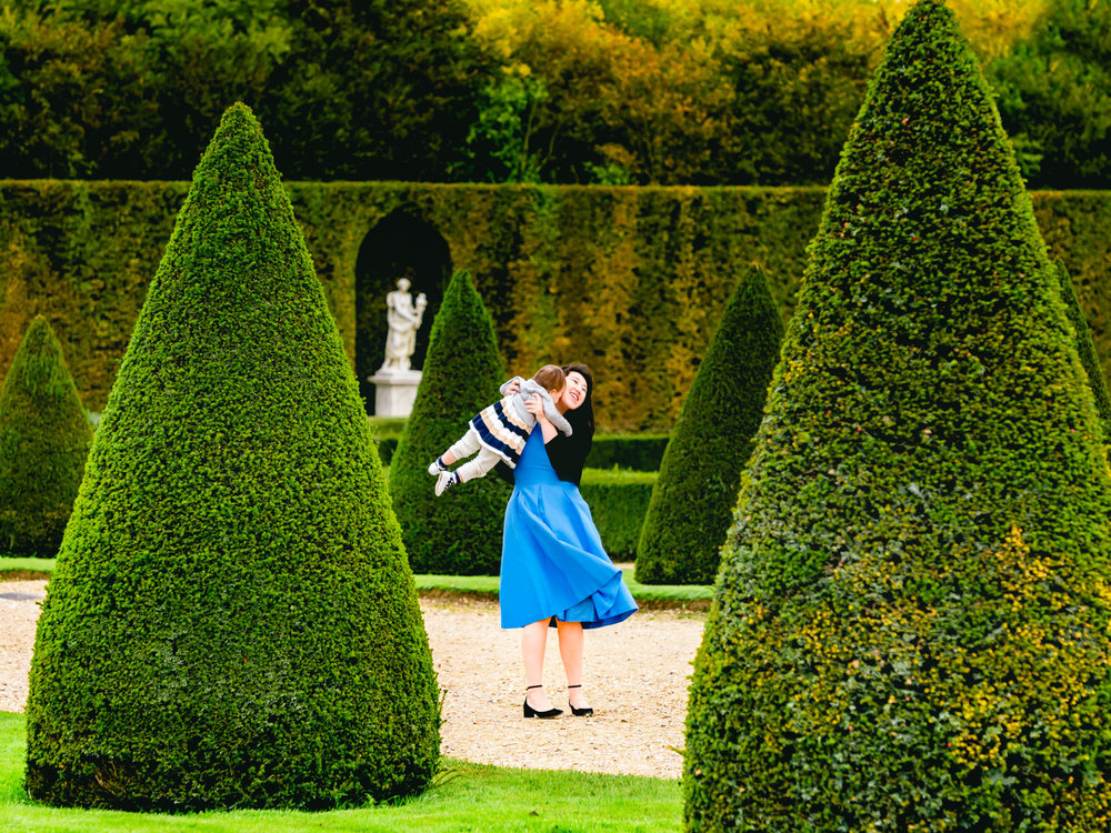 playing in the versailles gardens.