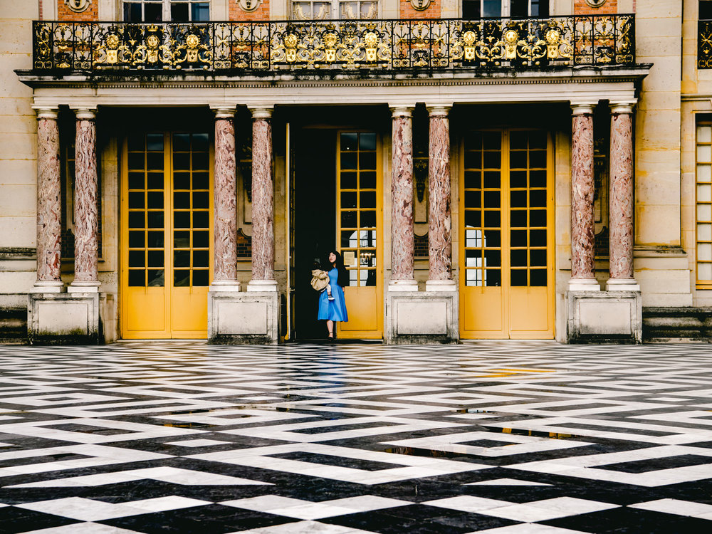 A checkered floor outside the palace of versailles.