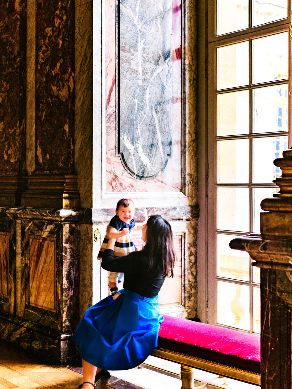 Playing with Lisa in the hall of mirrors in Versailles.