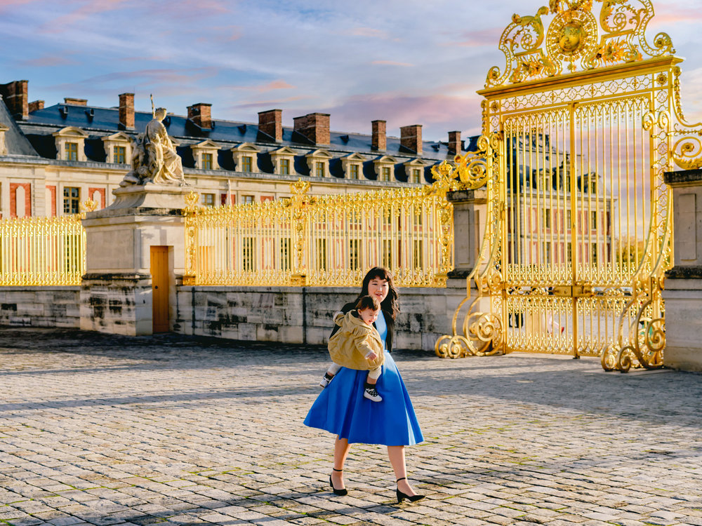 Walking by the gates of the palace of versailles near Paris, France.