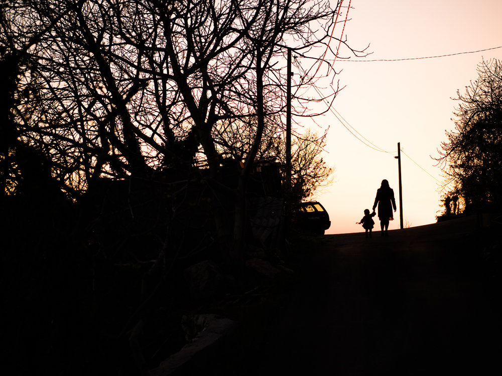 A silhouette of Dannie and Lisa in Zukovica, Montenegro after our day with Meanderbug.
